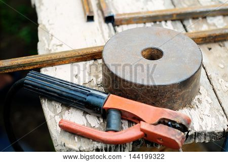 Still life with grindstone and welding holder on the table