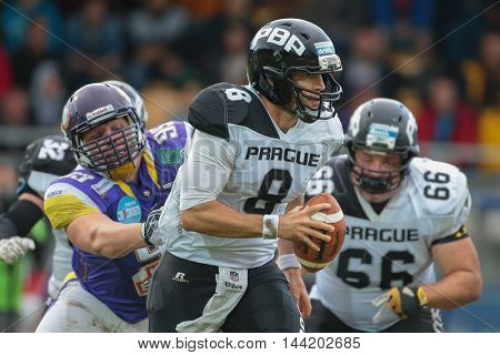 VIENNA, AUSTRIA - JUNE 20, 2015: QB Kyle Newhall Caballero (#8 Panthers) runs with the ball in a game of the Austrian Football League.