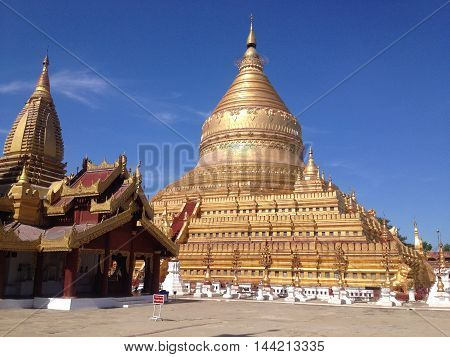 BAGAN MYANMAR - MAY 28 : Shwezigon Pagoda on May 28 2014 in Bagan. Bagan is ancient city with thousands of ancient temples and burmese most revered pagodas in Bagan Myanmar