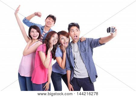 Happy teenagers taking pictures by themselves isolated on white background asian