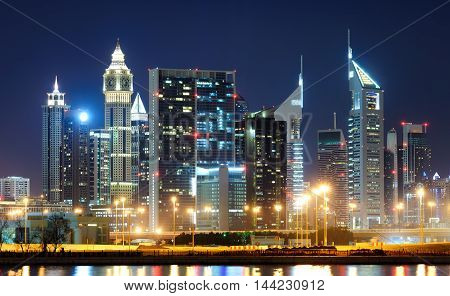 Amazing Tallest Skyscrapers In Sheikh Zayed Road Area During Calm Night With Colorful Neons. Downtow