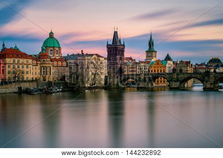 Amazing Towers Of Charles Bridge With Reflection At Vltava River During Cloudy Sunset, Prague, Czech