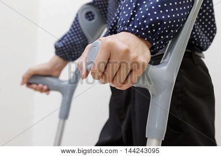 Closeup of woman with crutches walk rehabilitation