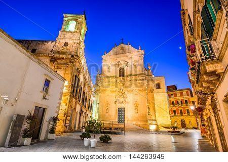 Martina Franca Puglia in Italy. Piazza Plebiscito and Basilica di San Martino at twilight.