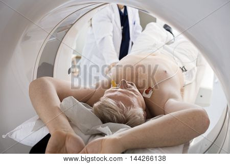 Man Going Through CT Scan In Hospital