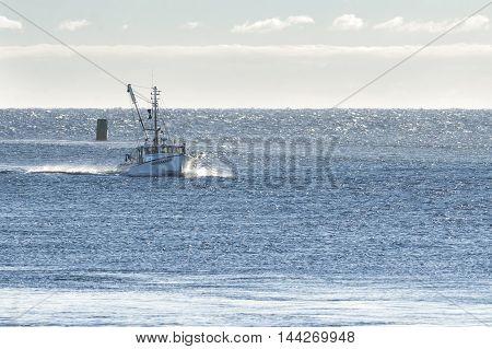 Sandwich Massachusetts USA - September 14 2014: Fishing boat returning from trip on windy Cape Cod Bay
