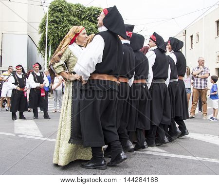 QUARTU S.E., ITALY - September 21, 2014: Parade of Sardinian costumes and floats for the grape festival in honor of the celebration of St. Helena. - Group of dancers in traditional Sardinian costume