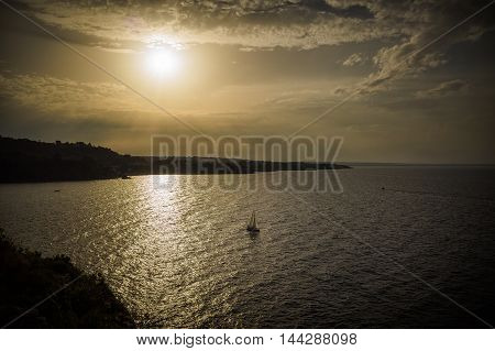 A boat sailing through the Gulf of Catania Sicily italy
