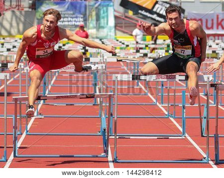KAPFENBERG, AUSTRIA - AUGUST 9, 2015: Florian Domenig (#34 Austria) and Kevin Grimschitz (#77 Austria) participate in the national track and field championship.
