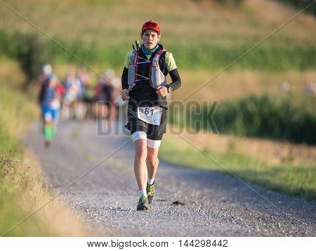 OBERGRAFENDORF, AUSTRIA - AUGUST 1, 2015: Sigrid Huber (#81 Austria participates in an Ultratrail running event.