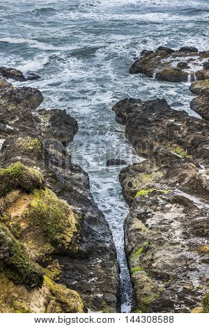Devil's churn or punchbowl chasm in Cape Perpetua Oregon