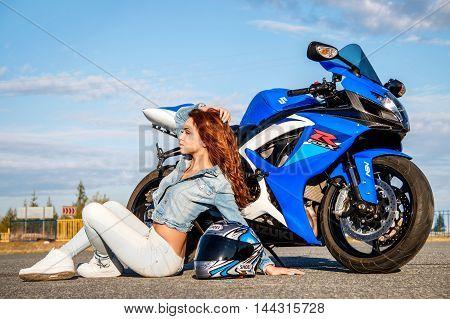 Pretty Young Woman And Suzuki Gsx-r750