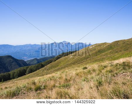 Along the path towards the summit of the mountain where lush valleys and thick forests