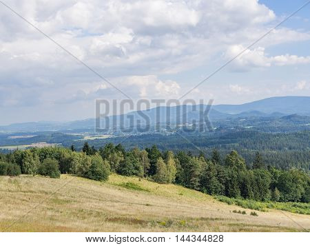 Beautiful hilly landscape with field and forest in Jelenia Gora Poland