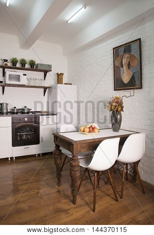 Interior of modern dining room with white brick wall and wooden floor