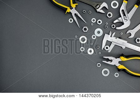 Pliers, Spanner With Adjustable Wrench And Vernier Caliper On Craftsmen Table