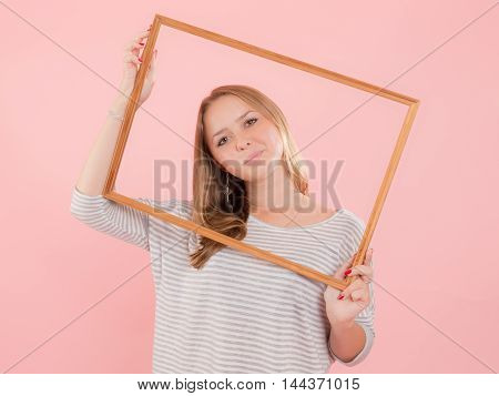 Portrait of a cheerful girl in a frame