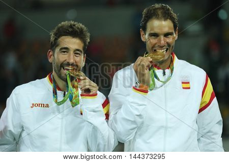 RIO DE JANEIRO, BRAZIL - AUGUST 12, 2016: Olympic champions Mark Lopez (L) and Rafael Nadal of Spain during medal ceremony after  victory at men's doubles final of the Rio 2016 Olympic Games at the Olympic Tennis Centre