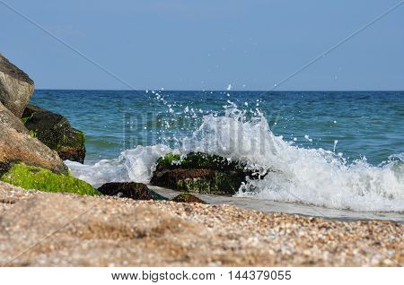 Sea waves breaking on the rocks. shore