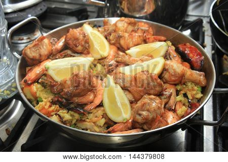 Fresh made paella spanish cuisine with seafood and meat