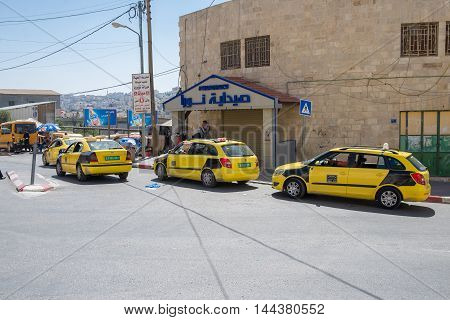 BETHLEHEM, PALESTINE - JUNE 2, 2015: Taxi waiting for tourists in Bethlehem
