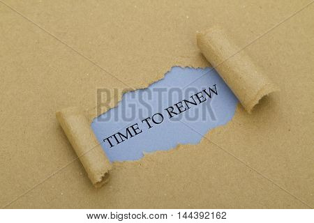TIME TO RENEW message written under torn paper.