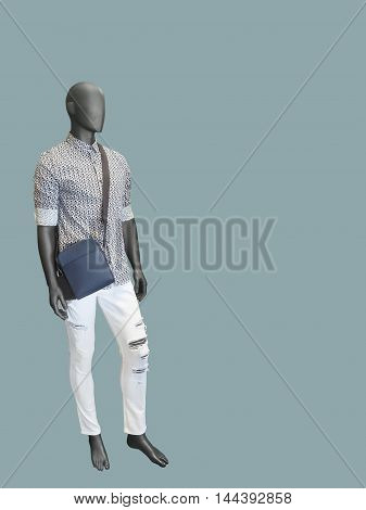 Full length male mannequin dressed in shirt and white jeans isolated. No brand names or copyright objects.