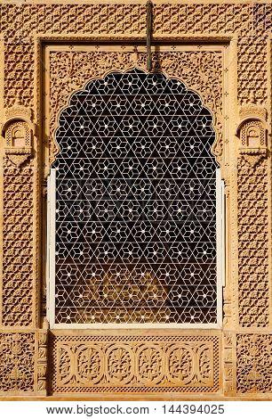 Ornate window of beautifolu Haveli in Jaisalmer city in India. Rajasthan.