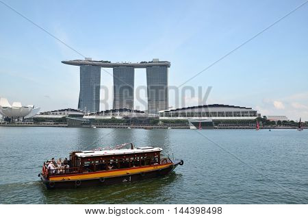 Ferry Boat And Skyline In Singapore