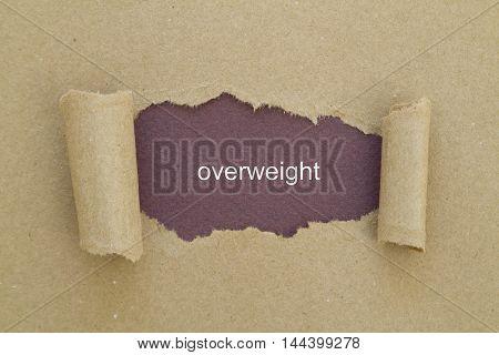 overweight word written under torn paper .