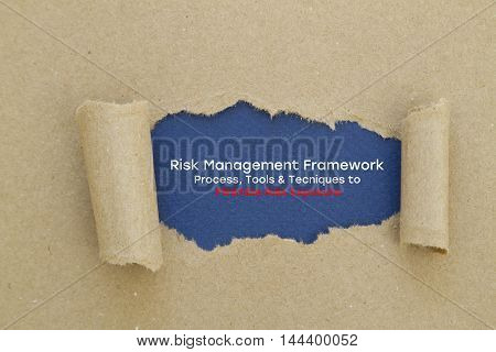 Risk Management Framework. Process, Tools & Techniques to Minimize Risk Exposure written under torn paper.