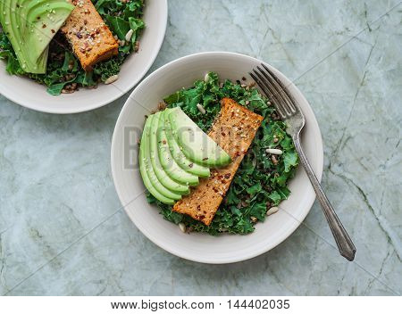 Kale Salad with Buckwheat, Pine Nuts and a Slice of Baked Cauliflower Loaf and Avocado/ Vegetarian Lunch/ Healthy Concept/ Selective Focus