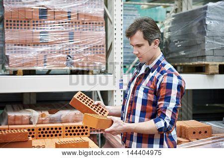 Man Chooses Building Brick In Store