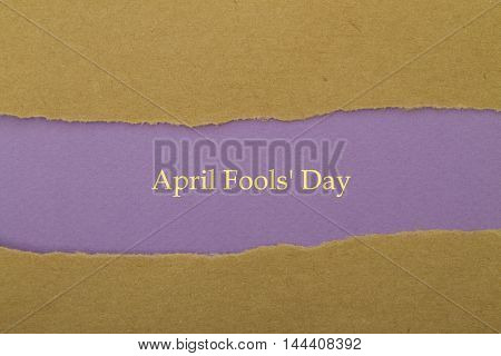 April Fool 's Day written under torn paper.
