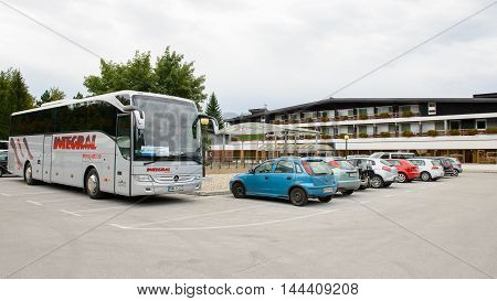 PLTVICE LAKES NATIONAL PARK AREA, CROATIA - AUGUST 19, 2014: Parking of the Hotel Jezera in Croatia. It is located in the central zone of the Plitvice Lakes National Park, which is a UNESCO World Heritage