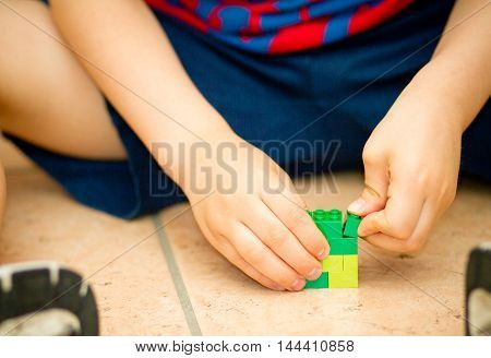 Orvieto, Italy - June 08th 2015: Child playing with lego bricks . Lego is a popular line of construction toys manufactured by the Lego Group