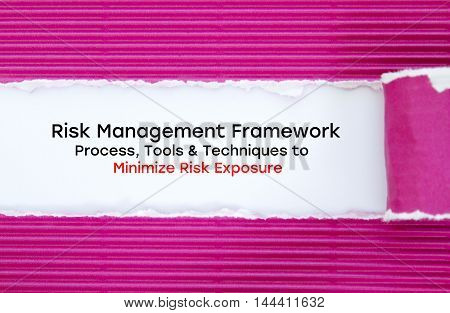 Risk Management Framework. Process, Tools & Techniques to Minimize Risk Exposure written under torn paper.