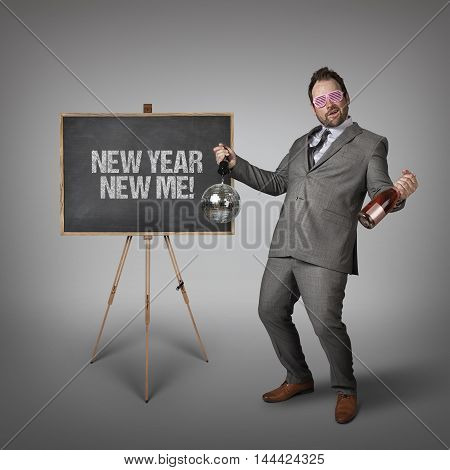 New year new me text on  blackboard with drunk businessman