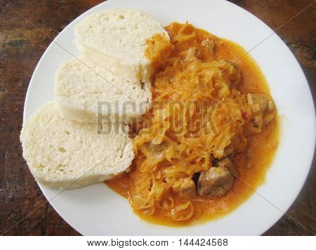 Homemade goulash with cabbage meat and dumplings (knedliky) traditional food from Eastern Europe countries Czech Republic, Slovakia, Austria