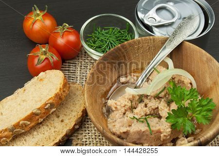 Crushed tuna canned. The fishing industry, canned fish. Diet food. Tinned tuna. Bowl with canned Tuna. Domestic food preparation.