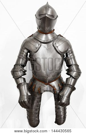 The armor in the Renaissance style. Medieval helmet and armor made of steel.