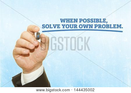 """Businessman hand writing """"When possible, solve your own problem"""" on a transparent wipe board. poster"""
