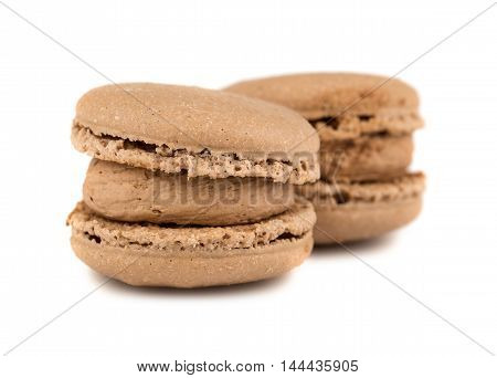 Pair of brown french macaroon cookies on white background
