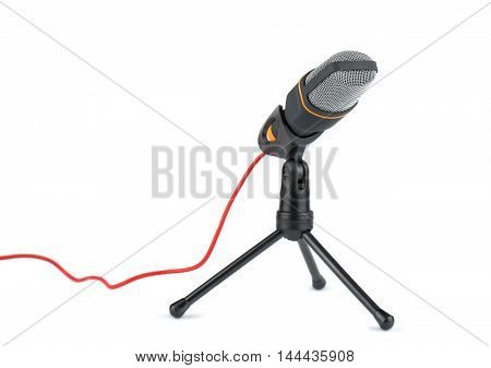 Black microphone with stand and red wire on white background