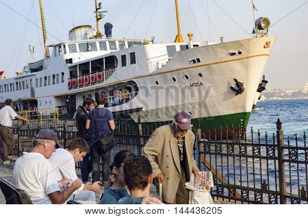 Istanbul Turkey - October 2 2012: Ferry in Karaköy pier. Port looks everyday life. Istanbul Ferries continue to serve as a key public transport link for many Thousands of commuters tourists and vehicles per day.