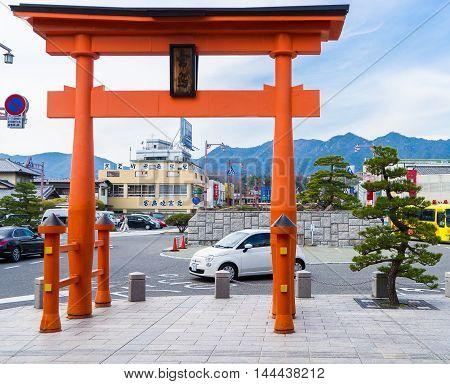 Hiroshima, Japan - March 16, 2016: Hiroshima on March 16, 2016. Cars are dropping tourists off at Miyajima pier for Miyajima ferry.