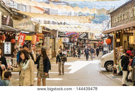 Hiroshima, Japan - March 16, 2016: Tourists are traveling along Miyajima shopping street.