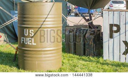 Exhibition Of Us Fuel Drums In A Reconstituted Military Camp