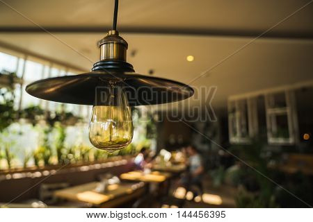 Lamps with Edison in the interior of a modern cafe.