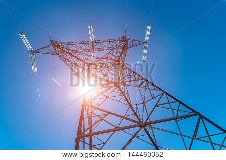 Beautiful sunset above the powerline and the blue clear sky